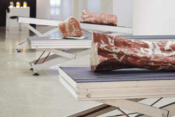 Yngve Holen - Extended Operations, 2013. Marble, inflight magazine, carpet, emergency floorpath evacuation system, honeycomb panel, stage element, 210 x 70 x 40 cm / 210 x 70 x 40 cm / 210 x 70 x 60 cm. Installation view Fridericianum © Photo, Achim Hatzius. Courtesy Yngve Holen, Johan Breggren Gallery, Malmö and Neue Alte Brücke, Frankfurt am Main.
