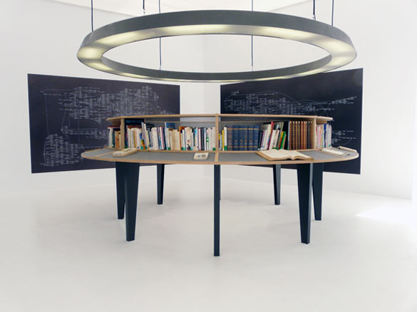 Julien Prévieux, La totalité des propositions vraies (avant), 2009. Livres, bibliothèque, lustre et impressions jet d'encre, dimensions variables / Books, book-case, ceiling light, inkjet prints, variable dimensions.